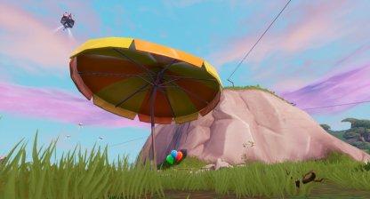 Rimbalza da un ombrellone gigante in 3 partite differenti Fortnite